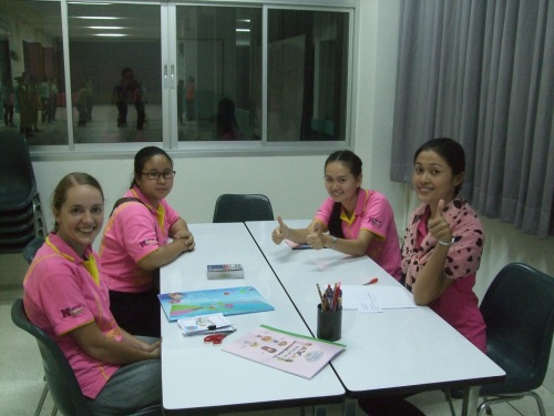 Amy teaches English to some staff ladies. It is Tuesday, so they all wear pink polos.