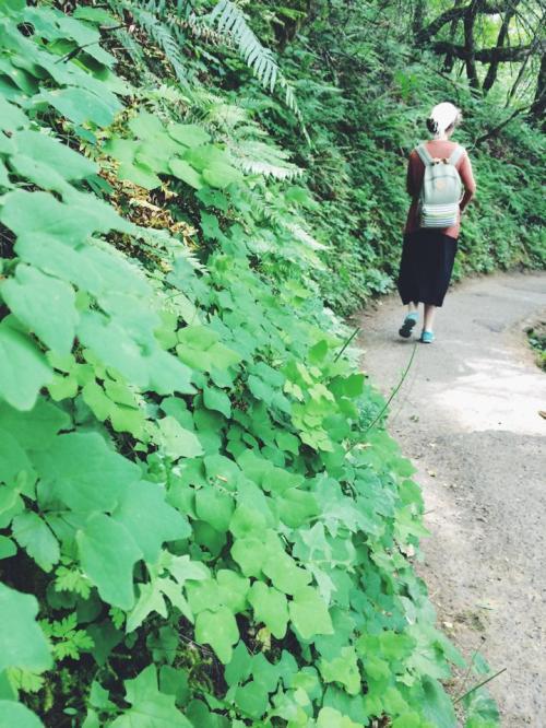 Emily Y walks down the trail.