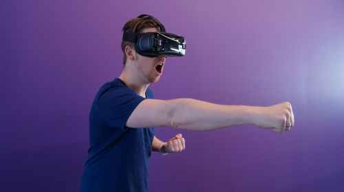 man using virtual reality headset doing an action
